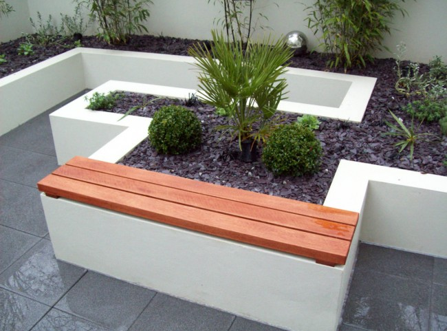 Seating area in a courtyard garden and raised borders