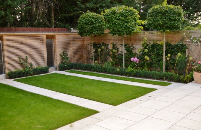 Modern Garden with Contemporary Slatted Fence