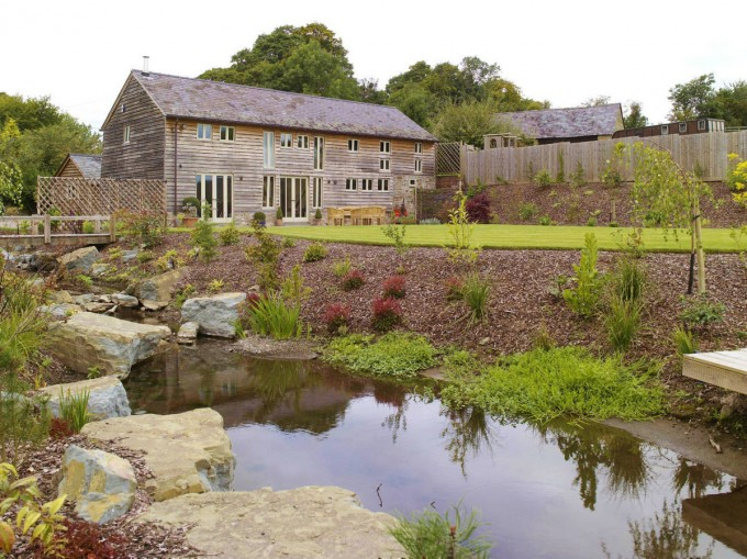 Border Oak house with natural water stream