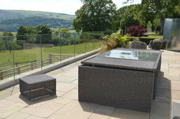 Natural Stone Paving and Glass Balustrade