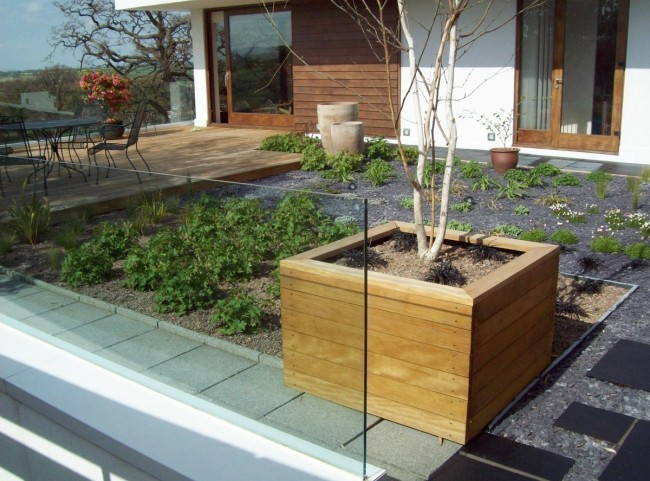 Wooden Planters and Glass Balustrade on Rooftop Garden