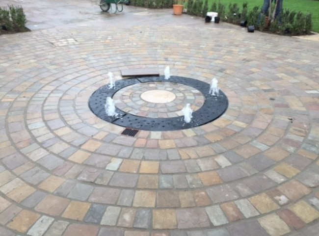 circular drive-over water feature